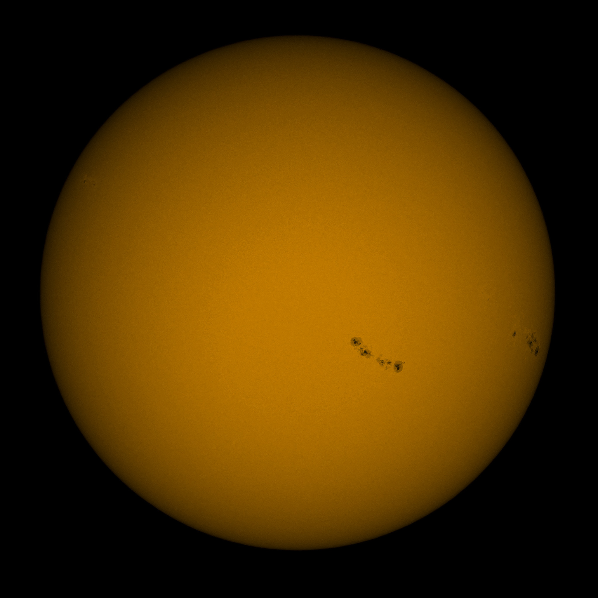 Active sun with four sunspot groups